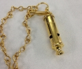 24k gold plating of a police whistle