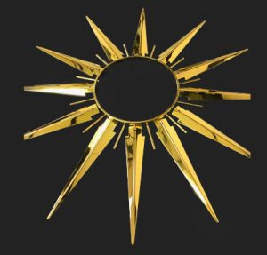 gold plating of a star shaped clock