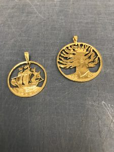 24k gold plating of two coin pendants