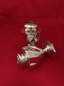 before and after image of silver plated oil lamps